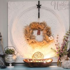 pampas grass woven into a wreath with cotton bolls and a dough bowl of leaves beneath.  Free and easy !