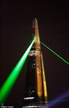 Laser lights shine from The Shard over Tower Bridge on July 5, 2012 in London, England