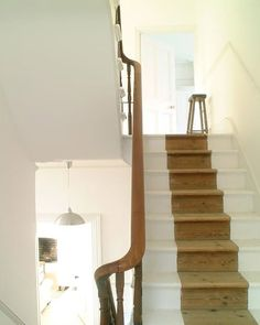 10 Creative Ways to Paint Your Stairs: Here's a fun idea that turns the painted stair runner on its head: instead of painting the middle of the stairs, paint the edges, so the 'runner' is the natural wood color. Painted Staircases, Painted Stairs, Wooden Stairs, Painted Floors, Spiral Staircases, Interior Stairs, Home Interior, Interior Design, Interior Architecture