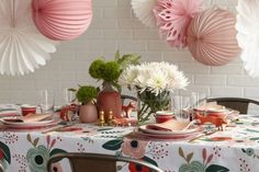 A whimsical tablecloth by Rifle Paper Co. was the inspiration for this tablescape.