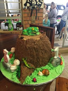 Tree trunk covered in bugs and creepy crawlies. Birthday Cake