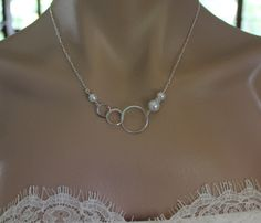 Bridal Necklace, Silver Triple Eternity and Pearl Necklace, Wedding Jewelry, Bridesmaid Gift. $34.50, via Etsy.