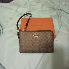 Authentic Coach wristlet NWT authentic coach wristlet with two credit card slots can easily fit Android or iPhone great for an additional wallet or for something smaller than a purse for a night out. Coach Bags Clutches & Wristlets