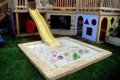 Deck with kids in mind. Sandbox, sliding board, home landscaping, colorful backyard playground, lawn gras. Backyard Playground, Backyard For Kids, Backyard Projects, Playground Slide, Natural Playground, Playground Ideas, Backyard Designs, Outdoor Toys, Outdoor Fun