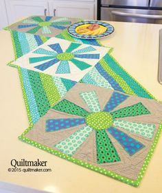 Lunch in the Sunshine table runner pattern: Every meal will be a happy one when this terrific quilted table runner designed by Beth Kerr Helfter graces the table.