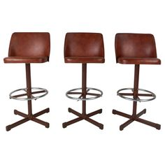 Set of Three Mid-Century Modern Barstools | From a unique collection of antique and modern stools at https://www.1stdibs.com/furniture/seating/stools/