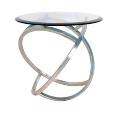 Create an uniquely contemporary atmosphere with this gracefully curved stainless steel framed glass-top accent table. This table adds a modern touch with the tempered, beveled glass top that gives your space an update. Round Glass Coffee Table, Glass End Tables, Sofa End Tables, Coffee Tables, Contemporary End Tables, Table Throw, Colorful Furniture, Modern Furniture, Furniture Design