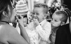 Kids stuffing marsh mellows into their mouths at Upper Court Gloucestershire / Documentary wedding photography by Ketch 22
