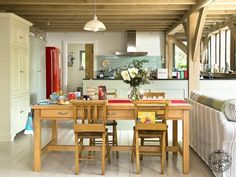 Timber frame kitchen within a timber frame home by Carpenter Oak
