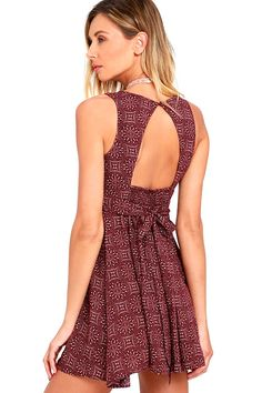 You will be the ultimate casual-cool chick in the Back to You Burgundy Print Skater Dress! Lightweight rayon, in an allover burgundy and cream print, covers a V-neck bodice with darting and tying sash. Open back with smocking and a top button sits above a flirty, skater skirt.