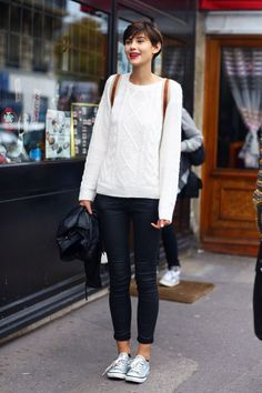 Black skinnies, white cable knit and back pack