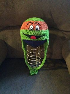Crocheted Ninja Turtle Michaelangelo (Mickey) ear flap hat with felt features. Could be used as part of a costume, and your childs eyes wouldnt have to be covered. Size: Child Small/Medium