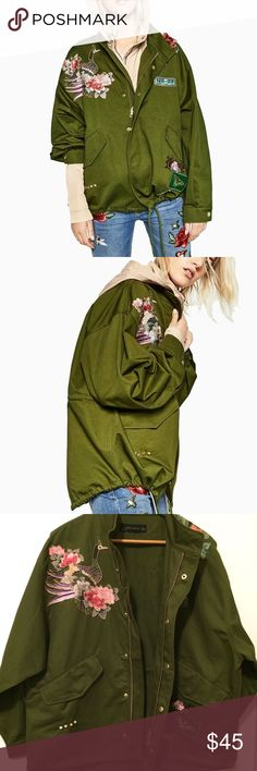 """ZARA Women Embroidered Green Parka Jacket - M: ZARA Women Embroidered Green Parka Jacket - M:  This oversized jacket is perfect for Chilly & Cool weather. Very fashionable!   *Gold Zipper & Fastenings *Two large front Pockets w/gold snap fastening *Hi-Low  *Embroidered on front & back *Drawstring waist & hem  Condition: Excellent! NEW WITH TAGS!   Measurements (Flat): Pit to Pit: Approx. 25"""" Length: Approx. 31"""" Zara Jackets & Coats Utility Jackets"""