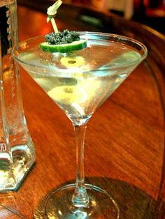 The Cavitini  ~~~  Ingredients:  1 slice cucumber * 10 grams caviar (The Russian Tea Room uses Wild American Hackleback) * Imperia vodka * 3 olives.   Combine vodka with ice in a shaker; shake vigorously 3-5 times. Pour into martini glass and garnish with olives, cucumber, and caviar.