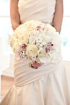 Beautiful Blooms - Lush bouquet featuring Garden Roses, Cymbidium Orchis, Calla Lilies, and Stephanotis with pale blue rhinestones for this shore wedding
