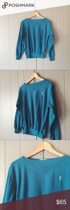 """🌙 YSL Rare Vintage Retro Teal Blue YSL Sweatshirt Super cute signature YSL sweatshirt in good condition! Cute boat like neck line. Teal blue in color. Does have some piling (see photos-you can zoom in with fingers). Lightweight and cozy.   Armpit to armpit is 20"""" Length is 23"""".  ✨✨✨ Offers are always welcome ✨✨✨ Yves Saint Laurent Tops Sweatshirts & Hoodies"""
