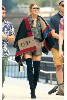 Stunning Olivia Palermo dressed in Burberry cape and Stuart Weitzman over-the-knee boots. #burberry #oliviapalermo