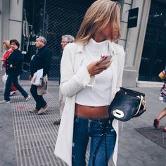 Medium wash skinny jeans, white crop top turtleneck, and white jacket. A cute and minimalist fall outfit.