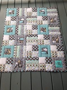 Campbell's quilt. Love the way the printed fabric is framed.