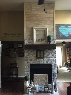 We built faux brick over existing tile and extended the brick higher than the original fireplace line. Added a new rough wood mantel and shiplap...