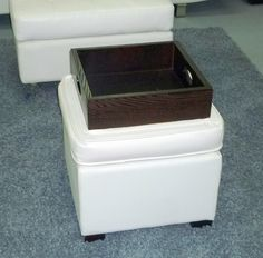 The flip top ottoman has a tufted surface, opens for storage, and the top reverses to a tray for serving. Ottoman, Surface, Tray, Storage, Design, Purse Storage, Store, Trays, Design Comics