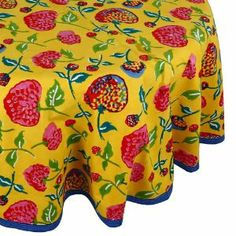 Enjoy your tea time stories on this vibrant Indian table cover. This is a 70 inch round tablecloth in 200-thread count cotton fabric. It is a floral themed tablecloth. There are flower settings in delightful shades of blue, green, red and pink over yellow background and there is a broad yellow border on all sides with floral patterns running along the border. This tablecloth is subtle and classy that would look delightful over your coffee or tea table in any season.