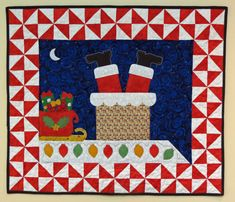 Whimsical Santa wall hanging quilt, designed by Sandi Colwell.  A pattern is available at Etsy.