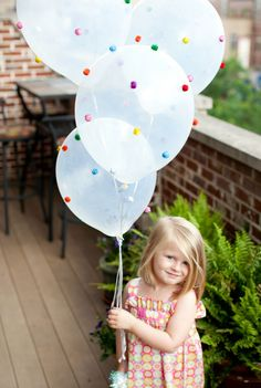 In just 15 minutes, you can turn plain balloons into party-ready decor. Use hot glue to affix small pom-poms (blogger Haeley suggests glittered ones) to helium grade latex balloons.  Get the tutorial at Design Improvised.   - CountryLiving.com