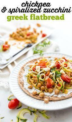Chickpea & Spiralized Zucchini Greek Flatbread - this is a quick meal that comes together in about 10 minutes. Perfect for lunch or dinner. Or you can even put an egg on it and call it brunch! Perfect for hot summer days. Learn how easy it is by clicking through to grab the recipe.