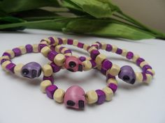 A personal favorite from my Etsy shop https://www.etsy.com/listing/259747840/girls-set-of-4-skull-wooden-stretchy