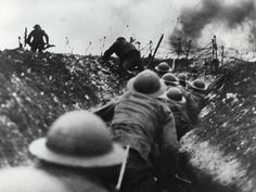 men hiding in trenches from the falling bombs.