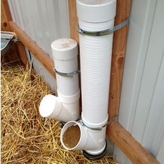 Free Choice Tube Feeders in Goat Shed