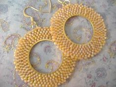 A personal favorite from my Etsy shop https://www.etsy.com/listing/193387864/golden-honey-seed-bead-earrings