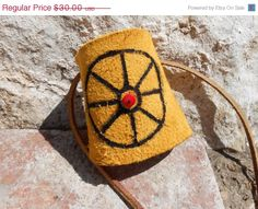 ON SALE Leather Cuff Bracelet with Hand by FaeMoonWolfDesigns, $22.50