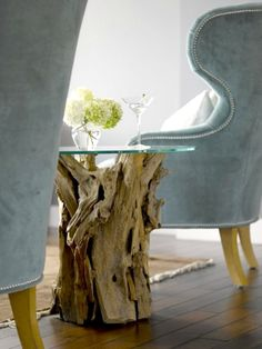 Crate and Barrel's Sun Bleached Driftwood Side Table in a Modern Washington State home: http://www.completely-coastal.com/2016/01/driftwood-side-table-shop-the-look.html
