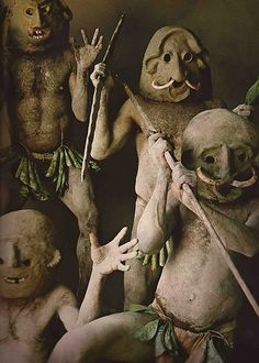 The Asaro Mudmen of Papua New Guinea.  Legend has it they were defeated by an enemy tribe and forced to flee into the Asaro River,  waiting until dusk before attempting to escape. The enemy saw them rise from the muddy banks covered in mud and thought they were spirits. Most tribes in Papua New Guinea are very afraid of spirits, so the enemy fled in fear. They then made masks with unusual designs from pebbles that they heated and water from the waterfall.