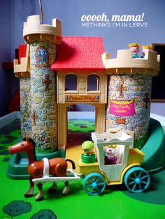 Vintage Fisher Price Play Castle. Make sure you click through. She has all of the cool features of the castle photographed. I love the secret trap door that drops little people into the moat below. The pink dragon is also pretty fab!