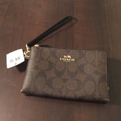 NWT Coach wristlet NWT Coach wristlet with the Signature C design. It's a double zipper with two slots in on of the pockets. Perfect to carry your items while going out. Can easily fit an iPhone 6 with a case on inside. Coach Bags Clutches & Wristlets