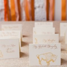 Animal stamps on escort cards!   Photo by Heather Waraksa