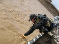 A Special Operations Weather Team member, measures the depth and flow rate of a river in Afghanistan. SOWTs use this data to determine whether or not a river is safe to cross on foot. (courtesy photo)