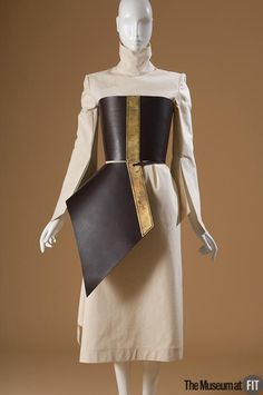 Ensemble: dress and corset (front view) | Brand: Boudicca (1997- ) | England, Fall 2001 | Off-white cotton canvas, brown leather, and brass | The Museum at FIT