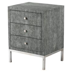 The perfect canvas for a lush bouquet of blossoms and a glossy stack of magazines, this chic side table showcases 3 drawers, a sleek steel base, and a textur...