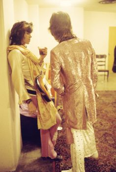 Keith Richards and Mick Jagger photographed backstage in 1972.