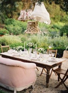 Eclectic mix of vintage pieces in the garden ~ I love this!
