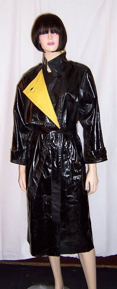 This slick black and yellow trench coat by StyleChic, Inc. is a must have for any womans wardrobe. The coat had been made in Canada and the fabric is a combination of cotton and polyurethane. It must be professionally dry cleaned only. It has buttons down the front of the coat for closure, buttons at the sleeves, and buttons at the front and back for decorative design purposes, and is belted. It is in excellent vintage condition and is a Size 6. The label is present and reads, StyleChicI…