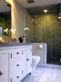 Transitional bathroom.  I love the marble floor tiles with the limestone counters.  Gray and white is a clean look.  Plus the shower wall/door and darker tiles in that area.  Modern and traditional.
