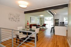 Warm Contemporary house FOR SALE. Floor to ceiling window, exposed steel beam, bamboo flooring, open concept. For sale in Canyon Rim, Salt Lake City, Utah