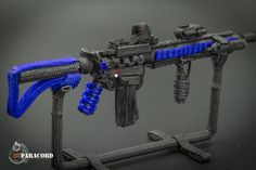 No, this isn't a real AR-15, it's a miniature made out of various types of paracord designed to replicate America's favorite rifle and made with stunning detail. This intricately handcrafted AR-15 replica features charging handle, interchangeable fore-grip with accessory rails, vertical forearm grip, EOTech Sight, lase
