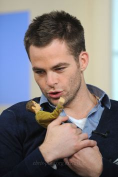 Chris Pine playing with himself as James T. Kirk doll. So cute and adorable!!