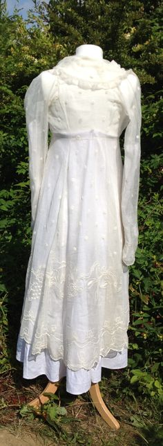 c1805 3/4 length summer pelisse or overdress. Gauze embroidered with dots, ivy and bluebells, Frilled collar. Scalloped edgeing. Ties at front waist.